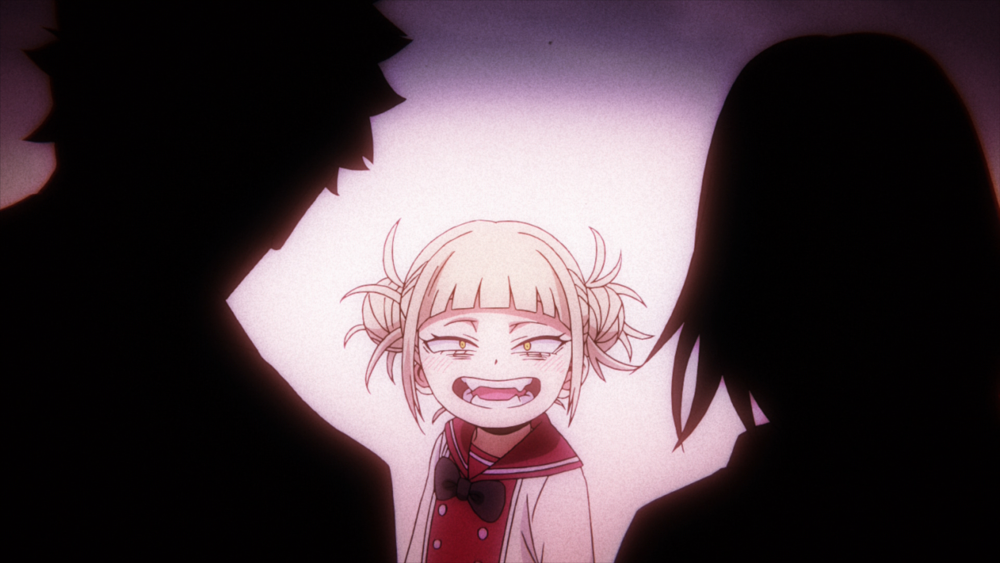 Toga from My Hero Academia as a young child. She still has that creepy, large grin that is associated with her unhinged personality.